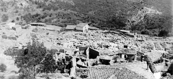 view of Kastri village in 1893 with the early excavations